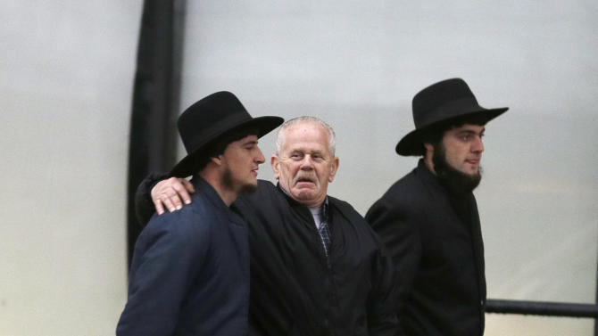 Amish men walk to the U.S. Federal Courthouse Friday, Feb. 8, 2013, in Cleveland.  A judge will sentence 16 Amish for hate-crimes convictions in beard- and hair-cutting attacks on fellow Amish Friday, a case that highlighted issues of dissent and rogue discipline amid an idyllic rural lifestyle of horse buggies and wood stoves. (AP Photo/Tony Dejak)