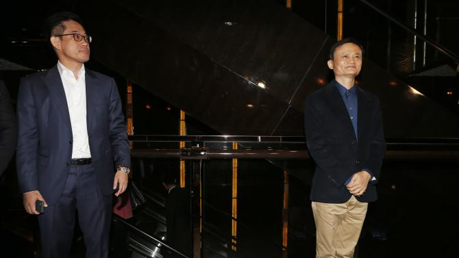 Alibaba Executive Chairman Jack Ma poses as he meets journalists ahead of an IPO roadshow, inside a hotel in Hong Kong