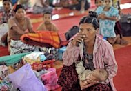 A Rakhine woman pictured with her baby at a refugee camp in Mrauk U, Myanmar, on October 28. At least 88 people have been killed in sectarian bloodshed in Myanmar this month, the authorities said Monday, with more than 26,000 others forced to flee a wave of rioting and arson