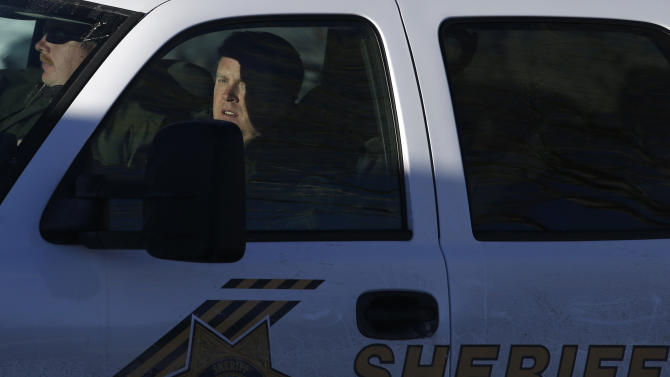 San Bernardino County Sheriff's officers leave the command post to search for former Los Angeles police officer Christopher Dorner in Big Bear Lake, Calif, Sunday, Feb. 10, 2013. The hunt for the former Los Angeles police officer suspected in three killings entered a fourth day in snow-covered mountains on Sunday, a day after the police chief ordered a review of the disciplinary case that led to the fugitive's firing and new details emerged of the evidence he left behind. (AP Photo/Jae C. Hong)