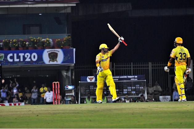 Chennai Super Kings batsman Suresh Raina celebrates his half century against Hyderabad Sunrisers at Champions League Twenty-20 Match at Jharkhand State Cricket Association (JSCA) International Cricket