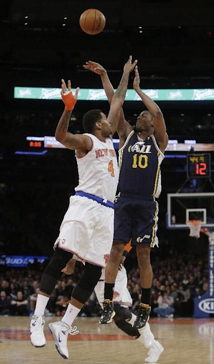 Utah Jazz's Alec Burks (10) shoots over New York Knicks' Jeremy Tyler (4) during the first half of an NBA basketball game on Friday, March 7, 2014, in New York