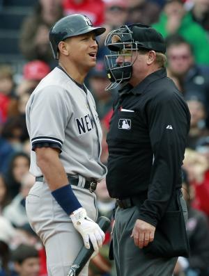 New York Yankees' Alex Rodriguez, left, reacts after being called out on strikes by home plate umpire Brian Runge, right, in the sixth inning of a baseball game against the Boston Red Sox, Sunday, Oct. 3, 2010, in Boston. (AP Photo/Michael Dwyer)