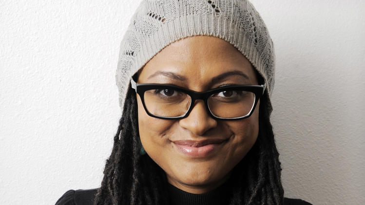 "In this Wednesday, Oct. 17, 2012 photo, Ava DuVernay, writer/director of the film ""Middle of Nowhere,"" poses for a portrait in Los Angeles. The rebirth of black independent film is taking place in a small office in the San Fernando Valley.  This is where filmmaker DuVernay and her staff of two operate AaFFRM, the African-American Film Festival Releasing Movement, a boutique distribution company dedicated to discovering and promoting black directorial voices. (Photo by Chris Pizzello/Invision/AP)"