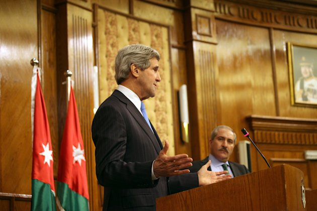 U.S. Secretary of State John Kerry, left, speaks during a joint news conference with his Jordanian counterpart, Nasser Judeh, right, in Amman Wednesday, May 22, 2013. Secretary of State John Kerry say