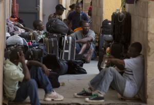 In this Jan. 13, 2015 photo, Haitian migrants wait …