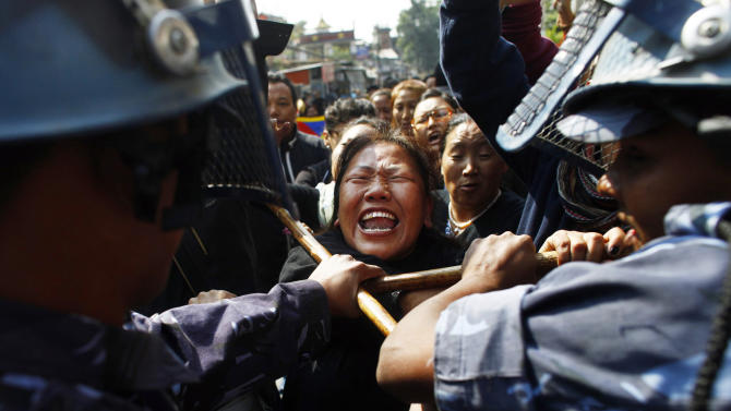 Nepal police detain a Tibetan who was shouting anti-China slogans in tribute to the Tibetans who died in the recent self-immolation, in Katmandu, Nepal, Tuesday, Nov. 1, 2011. Nepal police detained more than 100 Tibetans exiles who were protesting against Chinese rule over their homeland. (AP Photo/Niranjan Shrestha)