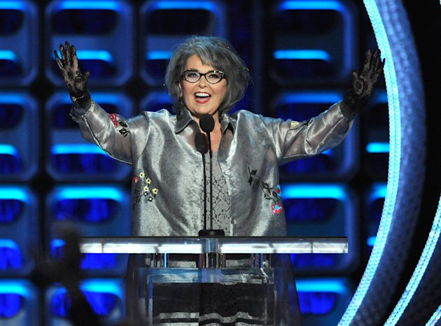 "FILE - In this Aug. 4, 2012 file photo, Roseanne Barr appears on stage at the Comedy Central ""Roast of Roseanne"" at the Hollywood Palladium, in Los Angeles. Barr will guest star on an episode of ""The Office"" and is scheduled to begin shooting Wednesday, Jan. 30, 2013. (Photo by John Shearer/Invision/AP, File)"