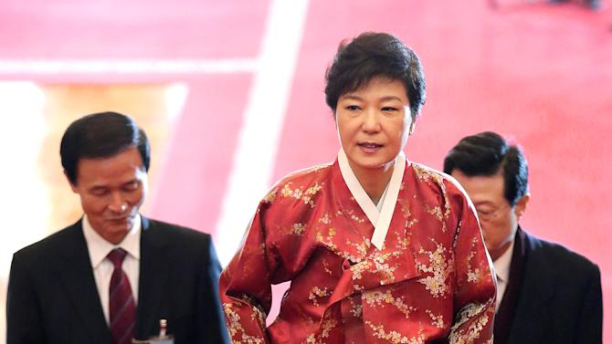 South Korean new President Park Geun-hye wearing a traditional dress arrives at the presidential house after her inauguration ceremony as the 18th South Korean President in Seoul, South Korea, Monday, Feb. 25, 2013. Park took office as the country's first female president Monday, returning to the presidential mansion she had known as the daughter of a dictator. (AP Photo/Yonhap, Jin Sung-chul)  KOREA OUT