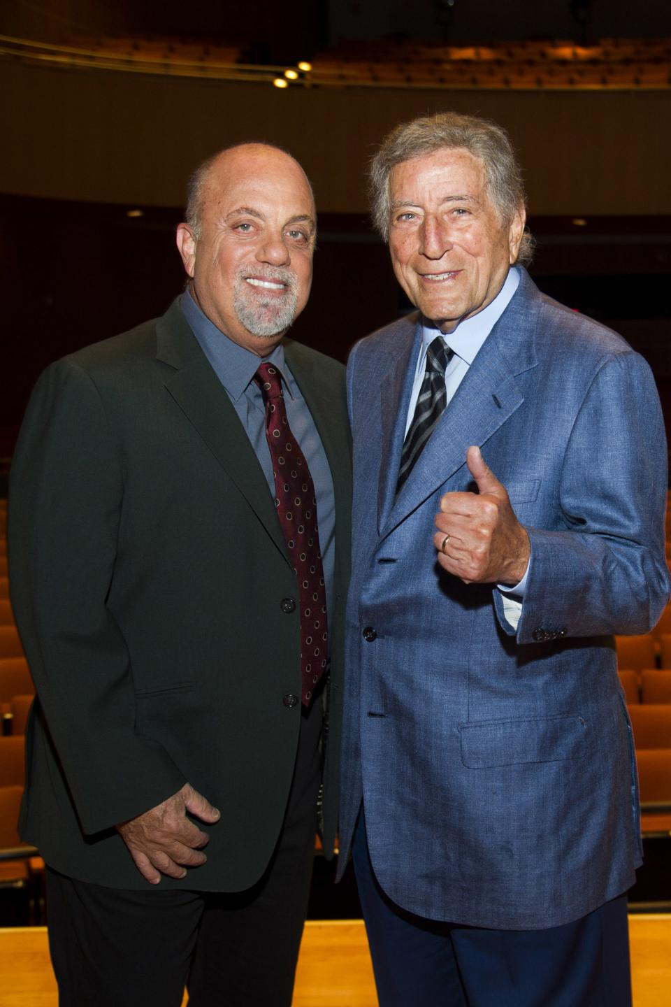 Billy Joel, left, and Tony Bennett pose on stage before a special master class school-wide assembly event for the Frank Sinatra School of the Arts, the public high school Bennett founded, on Thursday, May 30, 2013 in New York. (Photo by Charles Sykes/Invision/AP)