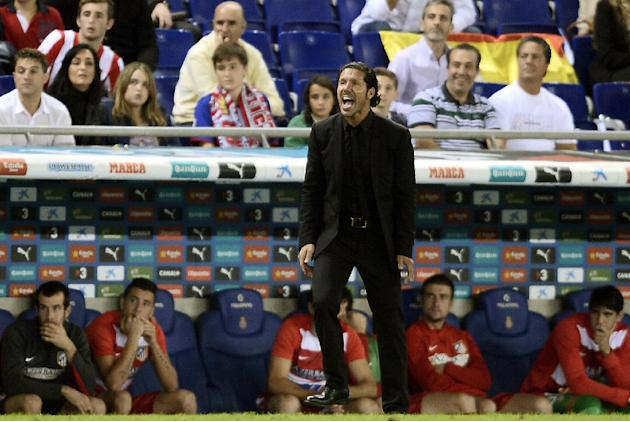 Atletico Madrid's coach Diego Simeone, from Argentina, yells during his team's Spanish La Liga soccer match against Espanyol at Cornella-El Prat stadium in Cornella Llobregat, Spain, Saturday, Oct. 19