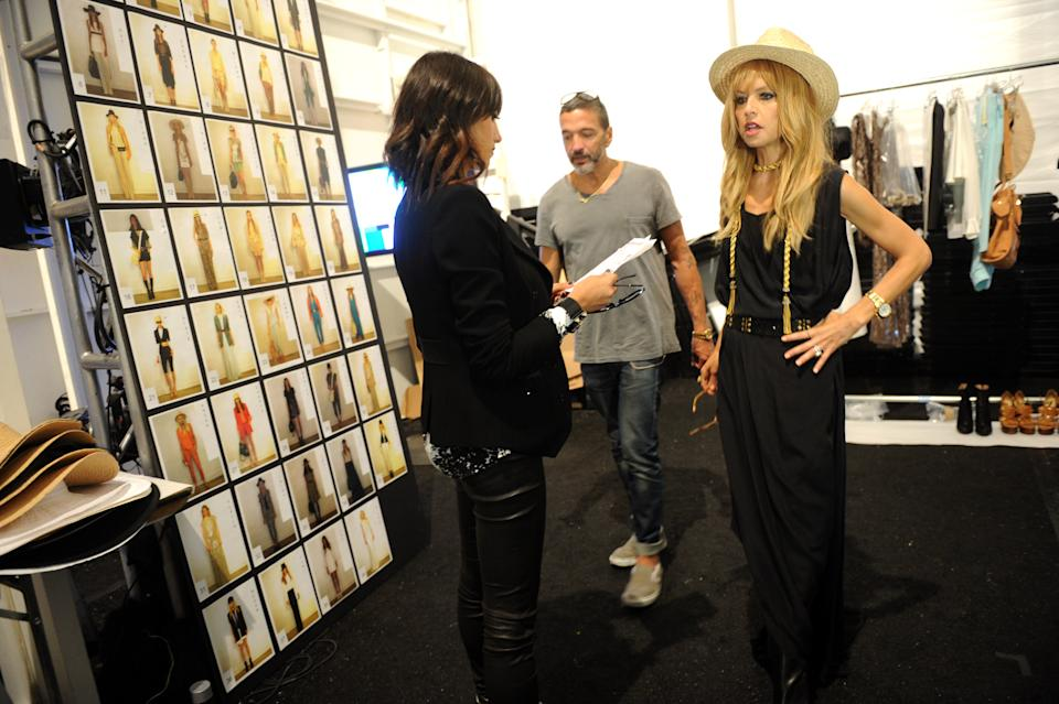 Designer Rachel Zoe, right, is seen backstage before her spring 2013 collection is shown at Fashion Week,  Wednesday, Sept. 12, 2012,  in New York. (Photo by Diane Bondareff/Invision/AP)