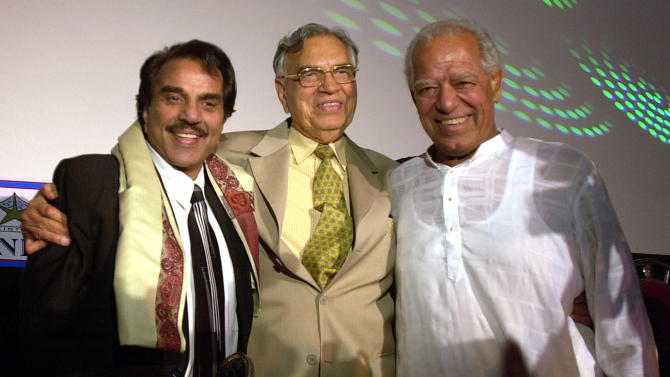 FILE- In this June 2, 2005 file photo, Indian wrestler and Bollywood action hero Dara Singh, right, poses with Bollywood actor Dharmendra, left, and then Madhya Pradesh Gov. Balram Jhakar, at the inauguration of a new cinema in Mumbai, India. Doctors said Dara Singh died Thursday, July 12, 2012 at his Mumbai home days after suffering a severe heart attack and stroke. He was 84. (AP Photo/Aijaz Rahi, file)