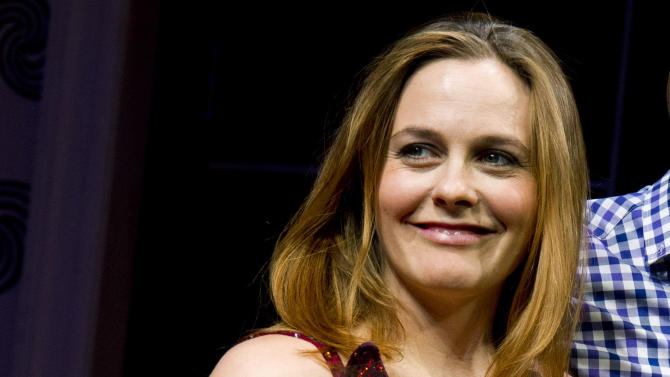 """Alicia Silverstone appears at the curtain call for the opening night performance of the Broadway play """"The Performers"""" on Wednesday, Nov. 14, 2012 in New York. (Photo by Charles Sykes/Invision/AP)"""