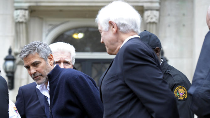 FILE - This March 16, 2012 file photo shows actor George Clooney and his father, Nick Clooney, right, being arrested during a protest at the Sudanese Embassy in Washington. The demonstrators were protesting the escalating humanitarian emergency in Sudan that threatens the lives of 500,000 people. Celebrities have courted politicians, and vice versa, since the dawn of Hollywood, but what happens when the alliance backfires, when the two worlds are suddenly speaking different languages? (AP Photo/Cliff Owen, file)