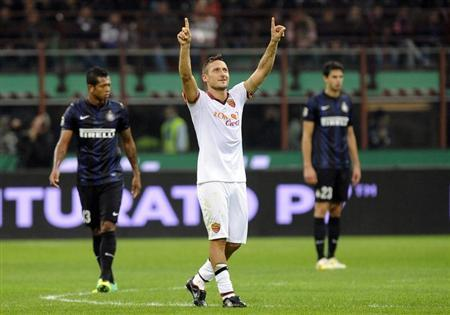 AS Roma's Totti celebrates after scoring against Inter Milan during their Italian Serie A soccer match in Milan