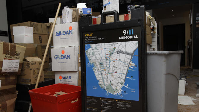 A map of Lower Manhattan and other items from the World Trade Center memorial visitor center are shown in the middle of a room after the walls were damaged by flooding in the wake of Superstorm Sandy, Monday, Nov. 5, 2012, in New York.  Although work continues on the visitor center Joe Daniels, president of the September 11 Memorial and Museum, said water that rushed into the site has been pumped out and the memorial will re-open to the public on Tuesday. (AP Photo/Kathy Willens)