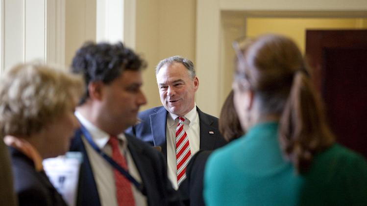 Sen.-elect Tim Kaine, D-Va., center, arrives at a freshman Senators luncheon on Capitol Hill in Washington, Tuesday, Nov. 13, 2012.(AP Photo/Harry Hamburg)