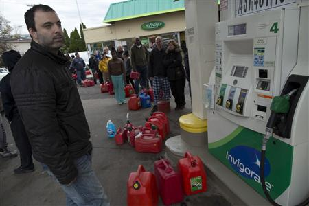 People stand in line for fuel at the corner of Hylan Boulevard and Reid Avenue in Staten Island