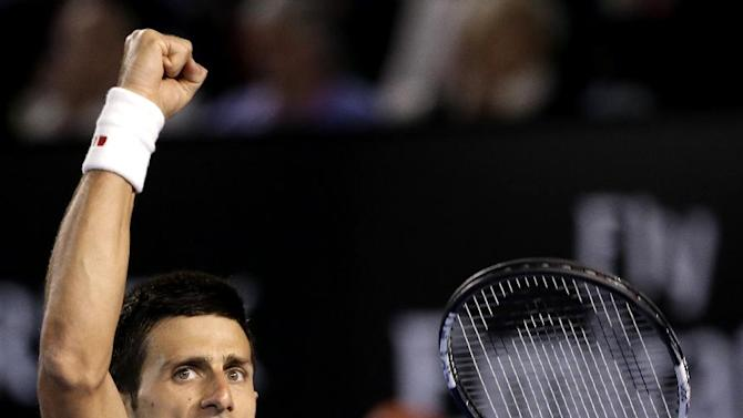 Novak Djokovic of Serbia celebrates a point won against Andy Murray of Britain during the men's singles final at the Australian Open tennis championship in Melbourne, Australia, Sunday, Feb. 1, 2015. (AP Photo/Vincent Thian)