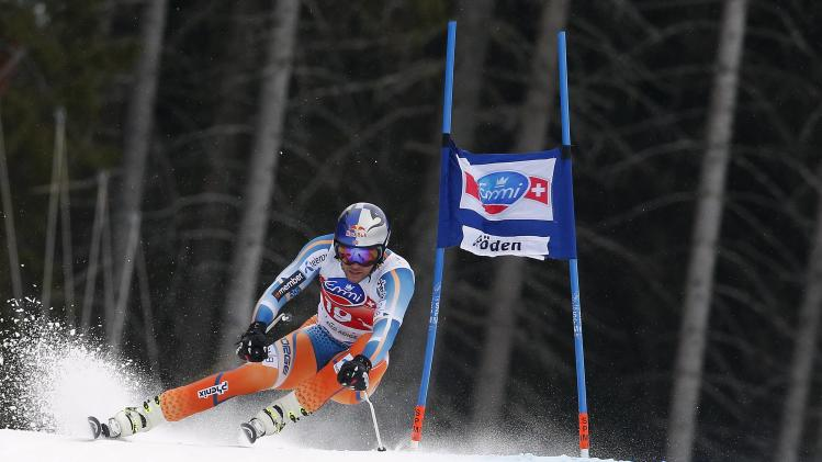 Svindal of Norway clears a gate during the men's World Cup Super-G skiing race in Val Gardena