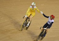 Britain's Victoria Pendleton shakes hands with Australia's Anna Meares after the latter won the gold medal in the London 2012 Olympic Games women's sprint final cycling event at the Velodrome in the Olympic Park in East London