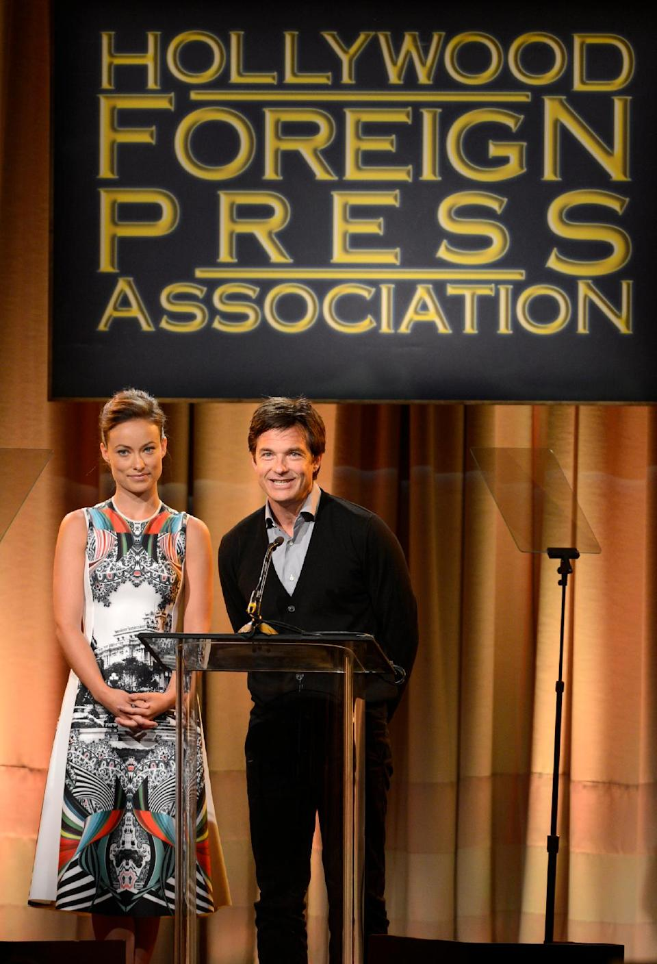 Olivia Wilde, left, and Jason Bateman speak on stage at the Hollywood Foreign Press Association Luncheon at the Beverly Hilton Hotel on Tuesday, Aug. 13, 2013, in Beverly Hills, Calif. (Photo by Chris Pizzello/Invision/AP)