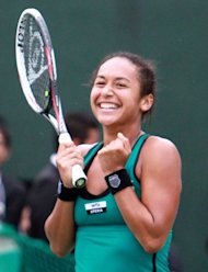 Heather Watson of Britain celebrates after winning the Japan Open in Osaka, on October 14. Watson defeated Chang Kai-chen of Taiwan in the final, 7-5, 5-7, 7-6 (7/4) and became the first Briton in 24 years to win a WTA title