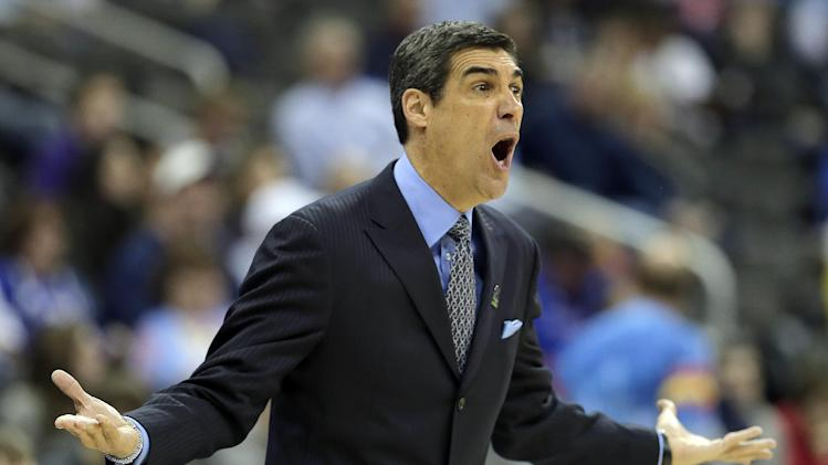 Villanova coach Jay Wright questions a call during the first half of a second-round game against North Carolina in the NCAA college basketball tournament Friday, March 22, 2013, in Kansas City, Mo. (AP Photo/Charlie Riedel)