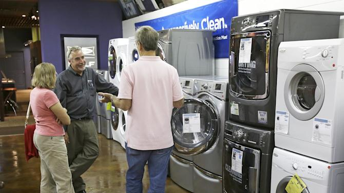 In this Tuesday, Jan. 8, 2013 photo, a salesman shows customers washers and dryers at Aggressive Appliances store in Orlando, Fla. Orders for U.S. factory goods that signal business investment plans jumped in January by the most in more than a year, suggesting companies are confident about their business prospects. The Commerce Department said Wednesday, Feb. 27, 2013,  that orders for so-called core capital goods, which include industrial machinery, construction equipment and computers, rose 6.3 percent in January from December. A sharp fall in demand for commercial aircraft caused overall durable goods orders to drop 5.2 percent, the first decline since August. (AP Photo/John Raoux)