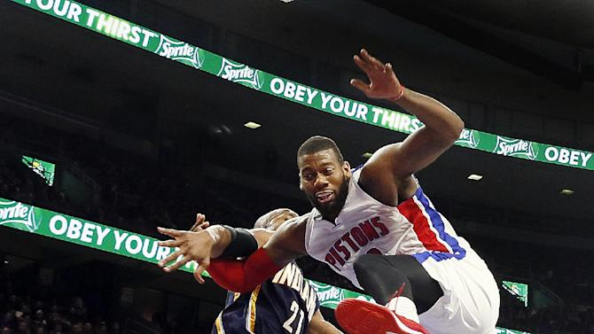 Detroit Pistons forward Greg Monroe, right, is fouled by Indiana Pacers forward David West (21) in the second half of an NBA basketball game in Auburn Hills, Mich., Friday, Dec. 26, 2014. (AP Photo/Paul Sancya)