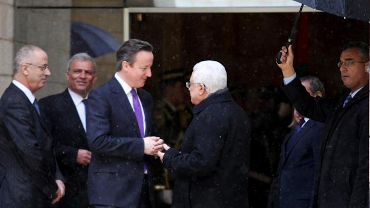 Palestinian President Mahmud Abbas (C-R) receives British Prime Minister David Cameron (C-L) during the latter's official visit to the West Bank biblical city of Bethlehem, on March 13, 2014