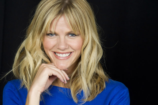 "In this May 9, 2012 photo actress Brooklyn Decker poses for a portrait in New York. A former swimsuit model, Decker is posing for the cameras more than ever. But now she's exchanged bathing suits for premiere-worthy gowns while on tour promoting her two new films, ""Battleship,"" and ""What to Expect When You're Expecting."" (AP Photo/Charles Sykes)"