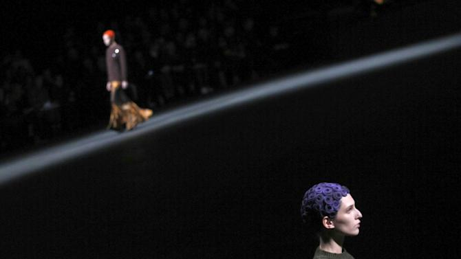 AP10ThingsToSee - Models wear creations by designer Riccardo Tisci for Givenchy as part of his Fall/Winter 2013-2014 ready-to-wear collection, in Paris, Sunday, March, 3, 2013. (AP Photo/Christophe Ena, File)