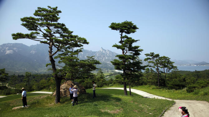 In this photo taken Thursday, Sept. 1, 2011, visitors tour the South Korean invested golf course in the Mount Kumgang resort, also known as Diamond Mountain,  in North Korea.  South Korea is asking foreign governments to ignore North Korea's push to open the tourist resort the Koreas once ran jointly to international investors.  (AP Photo/Ng Han Guan)