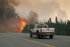 Willow Fire Capt. Leo Lashock responds to an out of control wildfire burning near Willow, Alaska