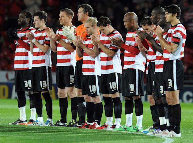 Doncaster Rovers Billy Sharp, centre, number 10, joins the minute's applause in memory of his son Louie Jacob Sharp, before the kick off of the English Football League Championship match against Middl