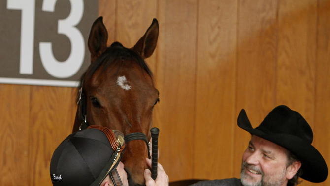 Jockey Calvin Borel greets his 2009 Kentucky Derby winning mount, Mine That Bird, with a kiss in the paddock at Churchill Downs Thursday, May 2, 2013 in Louisville, Ky. The 139th running of the Kentucky Derby is Saturday. (AP Photo/Garry Jones)