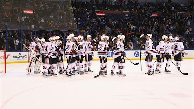 Chicago Blackhawks players congratulate each other after beating the St. Louis Blues at the Scottrade Center (AFP)