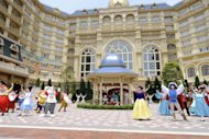This file photo shows Disney characters performing in front of Tokyo Disneyland hotel during a press preview, in Urayasu city in Chiba prefecture, in 2008. A week after Barak Obama became the first sitting US president to back gay marriage, Tokyo Disneyland confirmed that same-sex couples could hold their wedding ceremonies at the theme park
