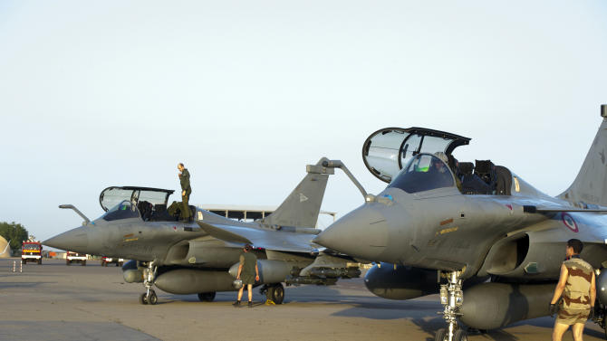 This Sunday Jan.13, 2013 photo provided by the French Army Monday Jan.14, 2013 shows French Rafale jetfighters on the tarmac after a mission to Mali in N'Djamena, Chad. French fighter jets bombed rebel targets in a major city in Mali's north Sunday, pounding the airport as well as training camps, warehouses and buildings used by the al-Qaida-linked Islamists controlling the area, officials and residents said. (AP Photo/Adj Nicolas-Nelson Richard, ECPAD)