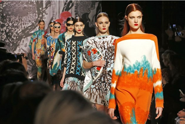 Models present creations by Japanese designer Tsumori Chisato a part of her Fall-Winter 2013/2014 women's ready-to-wear fashion show during Paris Fashion Week