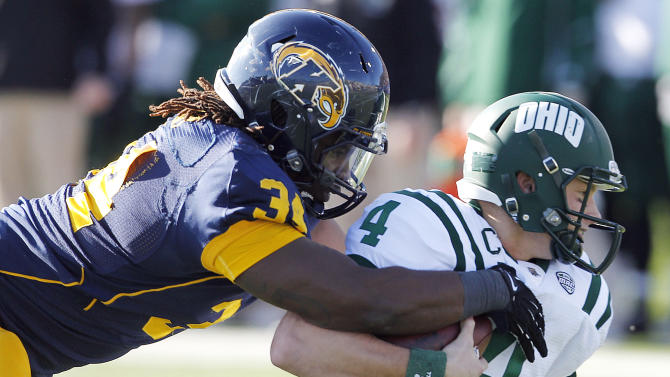 Kent State's Richard Gray sacks Ohio's Tyler Tettleton during the first quarter of an NCAA college football game, Friday, Nov. 23, 2012, in Kent, Ohio.  (AP Photo/Ron Schwane)