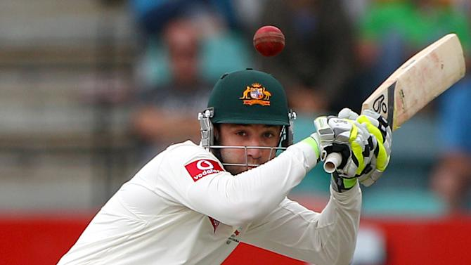 In this Dec. 14, 2012 file photo, Australia's Phil Hughes ducks under a bouncer from Sri Lanka's Shaminda Eranga on the first day of their cricket test match at Bellerive Oval in Hobart. Test hopeful Hughes has been taken to a Sydney hospital after being struck on the head while batting during a domestic first-class match on Tuesday, Nov. 25, 2014. (AP Photo/Rick Rycroft, File)