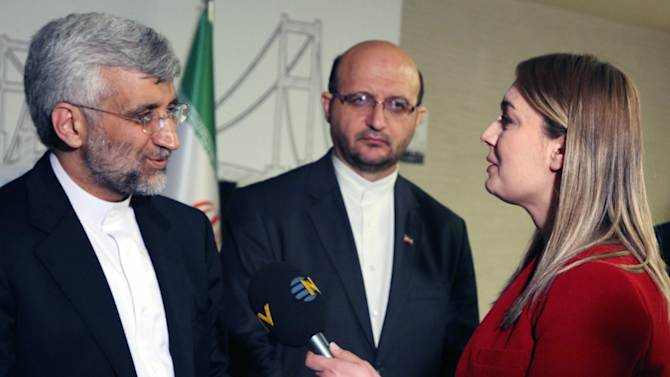 """FILE - In this April 14, 2012 file photo, Didem Tuncay, then a diplomatic reporter for Turkish news channel NTV, interviews Iran's Chief nuclear negotiator Saeed Jalili in Istanbul, Turkey. Tuncay, a respected television journalist, 38, was injured after a suicide bomber detonated an explosive device at the entrance of the U.S. Embassy in the Turkish capital, Ankara, Turkey, Friday, Feb. 1, 2013, A hospital official said she was """" not in a critical conditoion."""" (AP Photo/Burhan Ozbilici, File)"""