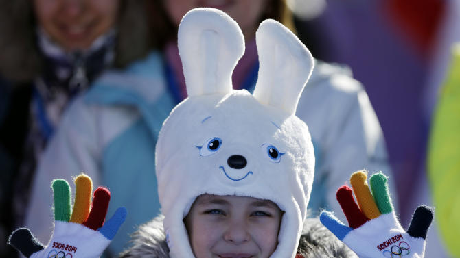 A girl wears a hat in the shape of the Sochi Winter Olympics mascot while watching the men's snowboard slopestyle qualifying at the Rosa Khutor Extreme Park ahead of the 2014 Winter Olympics, Thursday, Feb. 6, 2014, in Krasnaya Polyana, Russia. (AP Photo/Andy Wong)