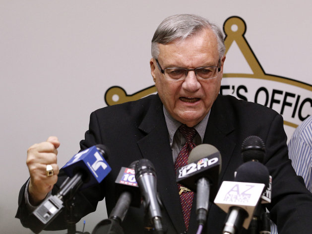 FILE - In this May 10, 2012 file photo, Maricopa County Sheriff Joe Arpaio pounds his fist on the podium during a news conference in Phoenix as he answers questions regarding the Department of Justice&#39;s federal civil lawsuit against him and his department. Arpaio, known nationally for his hardline stance on illegal immigration, is expected to take the witness stand Tuesday, July 24, 2012 and face allegations that his trademark immigration sweeps amounted to racial profiling against Hispanics. (AP Photo/Ross D. Franklin, File)