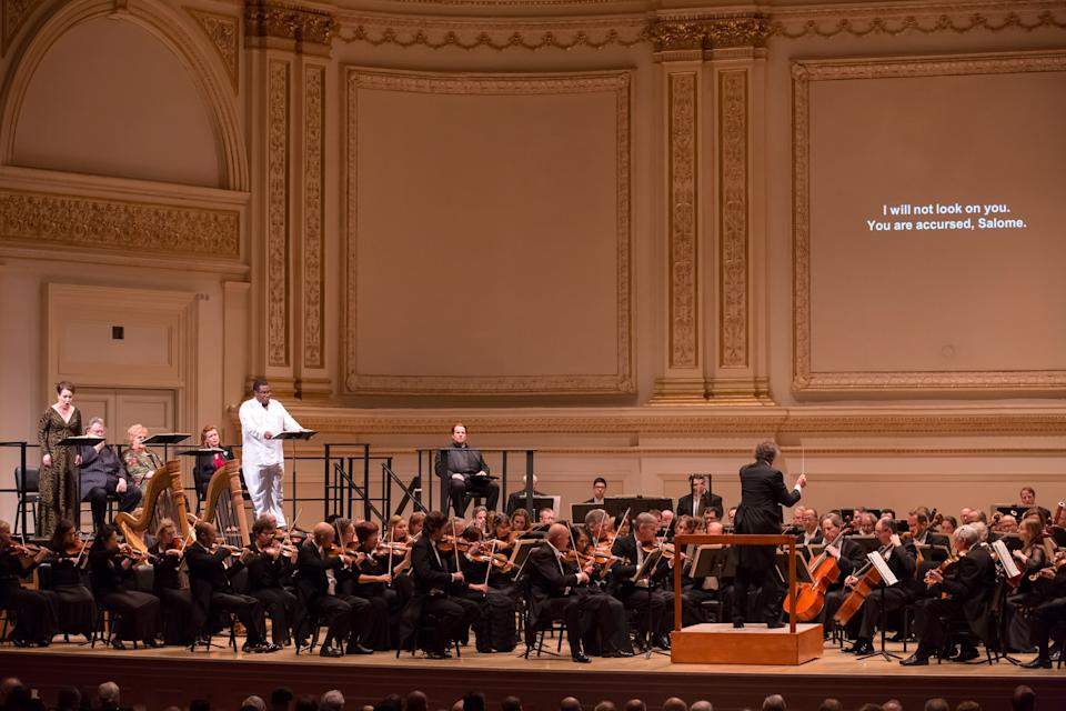 In this May 24, 2012, provided by Carnegie Hall, Swedish soprano Nina Stemme, left, sings in the title role of Salome with Eric Owens, wearing white, perfoming as Jochanaan with the Cleveland Orchestra at Carnegie Hall in New York. (AP Photo/Carnegie Hall, Chris Lee)