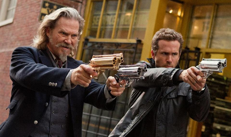 "This film publicity image released by Universal Pictures shows Jeff Bridges, left, and Ryan Reynolds in a scene from ""R.I.P.D."" The film will be released nationwide on Friday, July 19. (AP Photo/Universal Pictures, Scott Garfield)"