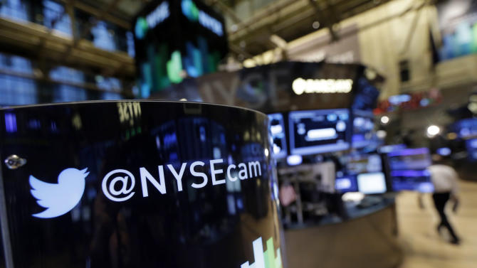 FILE - In this Monday, Nov. 4, 2013, file photo, an updated phone post on the floor of the New York Stock Exchange features a Twitter logo, in New York. Twitter Inc. reports quarterly earnings on Wednesday, Feb. 5, 2014. (AP Photo/Richard Drew)